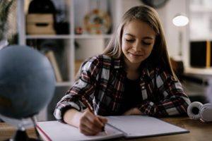 teen doing schoolwork through her academic program in Utah